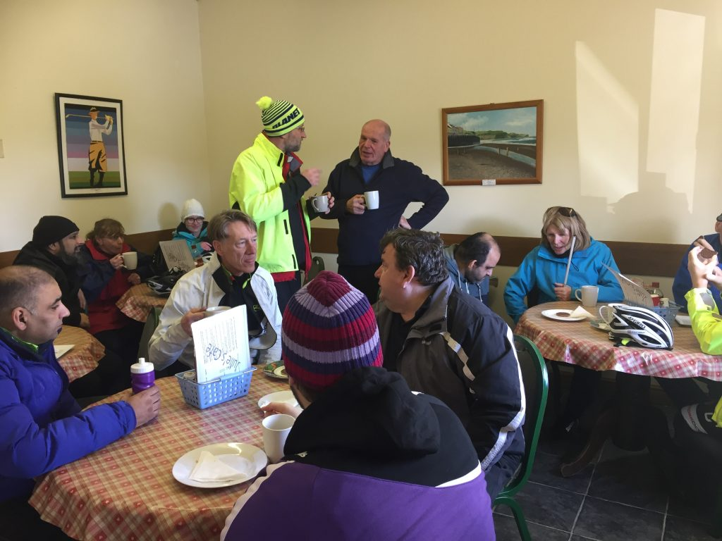 Will we or won't we ride today; Barney and Damian mull over options as other seated trekkers sup their brews.