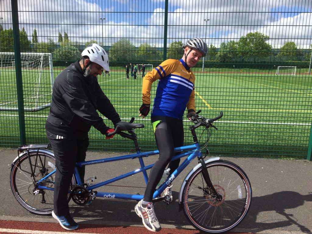 Pilot John H. and Ahmed getting on a new Tandem